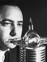 "Theodore Harold ""Ted"" Maiman with his laser in July 1960"