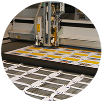 Exact cutting of printed materials