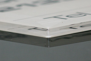 Cut edge of acrylic plate